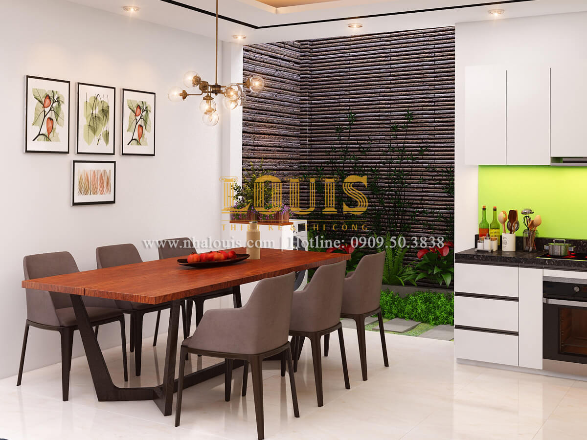 Phòng bếp và phòng ăn thiết kế nhà ống mặt tiền 5m có gara ô tô tại Tân Bình