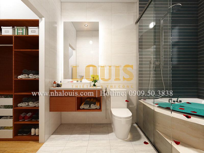 Phòng tắm và WC thiết kế nhà ống mặt tiền 5m có gara ô tô tại Tân Bình
