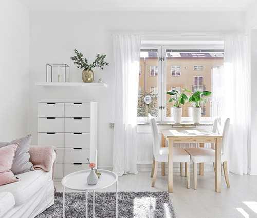 Không gian đủ đầy bên trong căn hộ 28m2 màu trắng