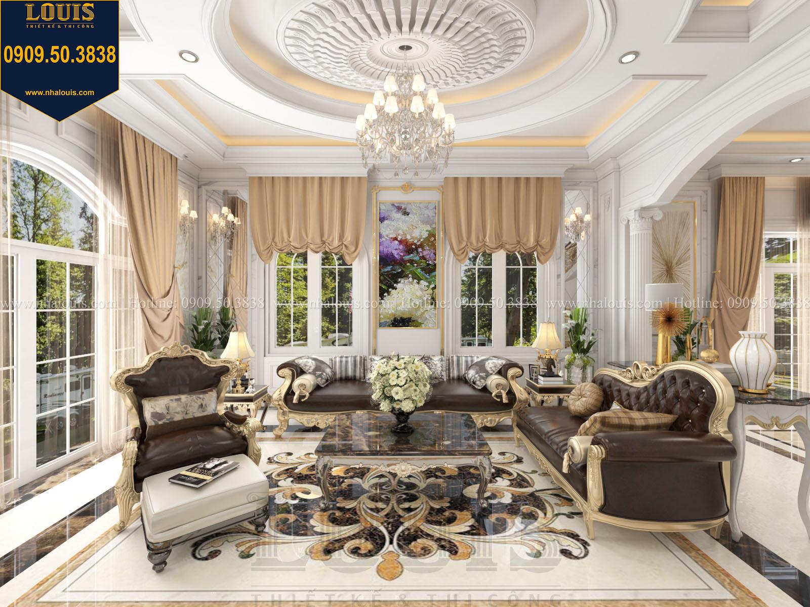 Phòng khách biệt thự 2 tầng đẹp với sofa bọc da nâu sang trọng - 013