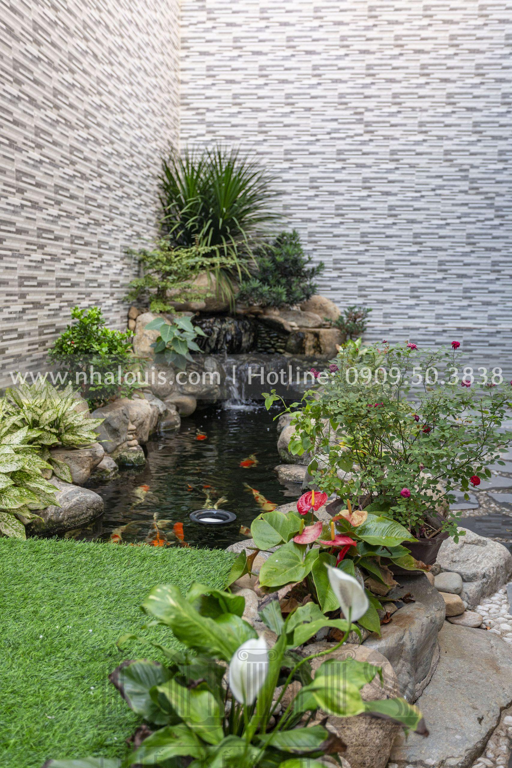 sân vườn biệt thự 3 tầng mái Mansard tại Bình Dương
